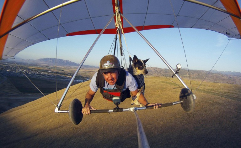 Dan McManus and his service dog Shadow hang glide together outside Salt Lake City, Utah, July 22, 2013. McManus suffers from anxiety and Shadow's presence and companionship help him to manage the symptoms. The two have been flying together for about nine years with a specially made harness for Shadow. (Jim Urquhart/Reuters)