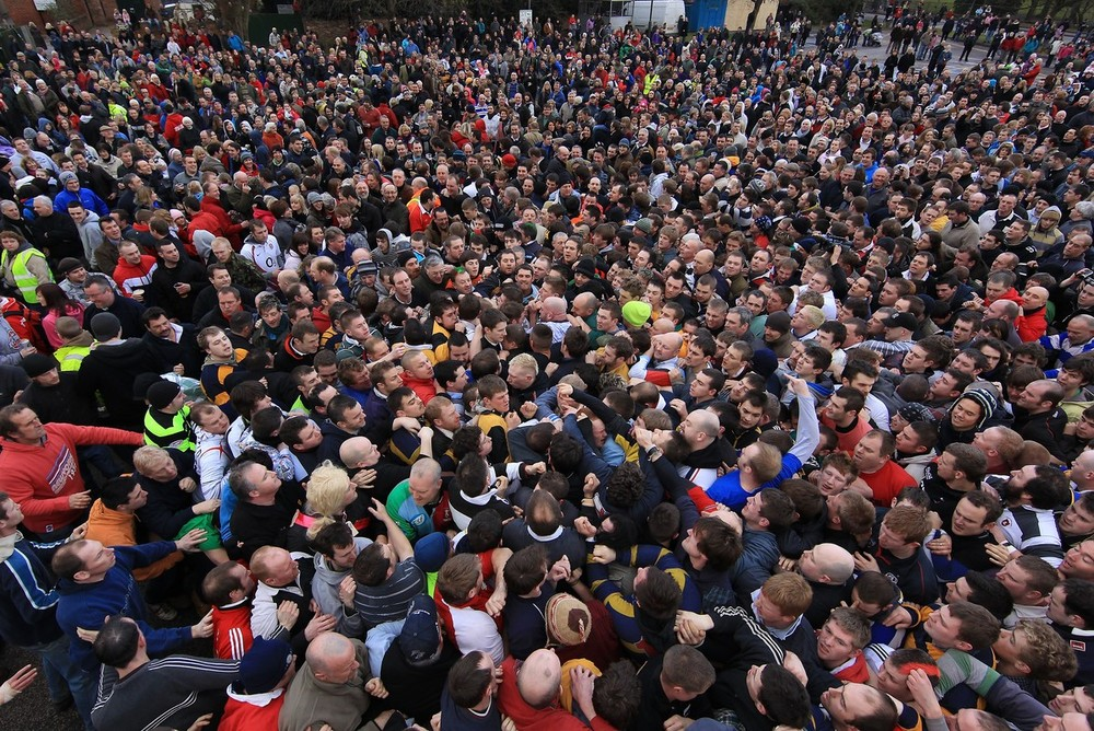 Enthusiasts Participate In The Royal Shrovetide Football Match