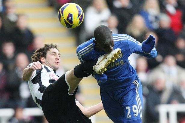 Fabricio+Coloccini+vies+for+the+ball+with+Chelsea's+Demba+Ba