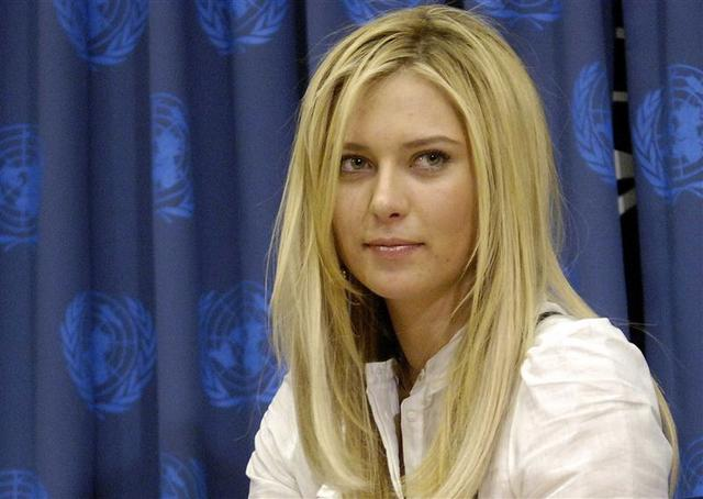 Sharapova looks up after she signs becomes a Goodwill Ambassador for the United Nations Development Programme in New York