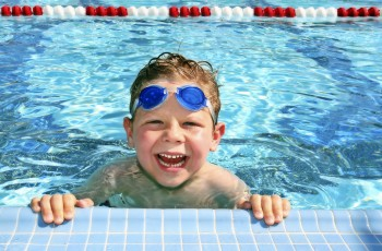 boy_child_water_swimming_pool_happy_smile_stockphoto_3456x2304